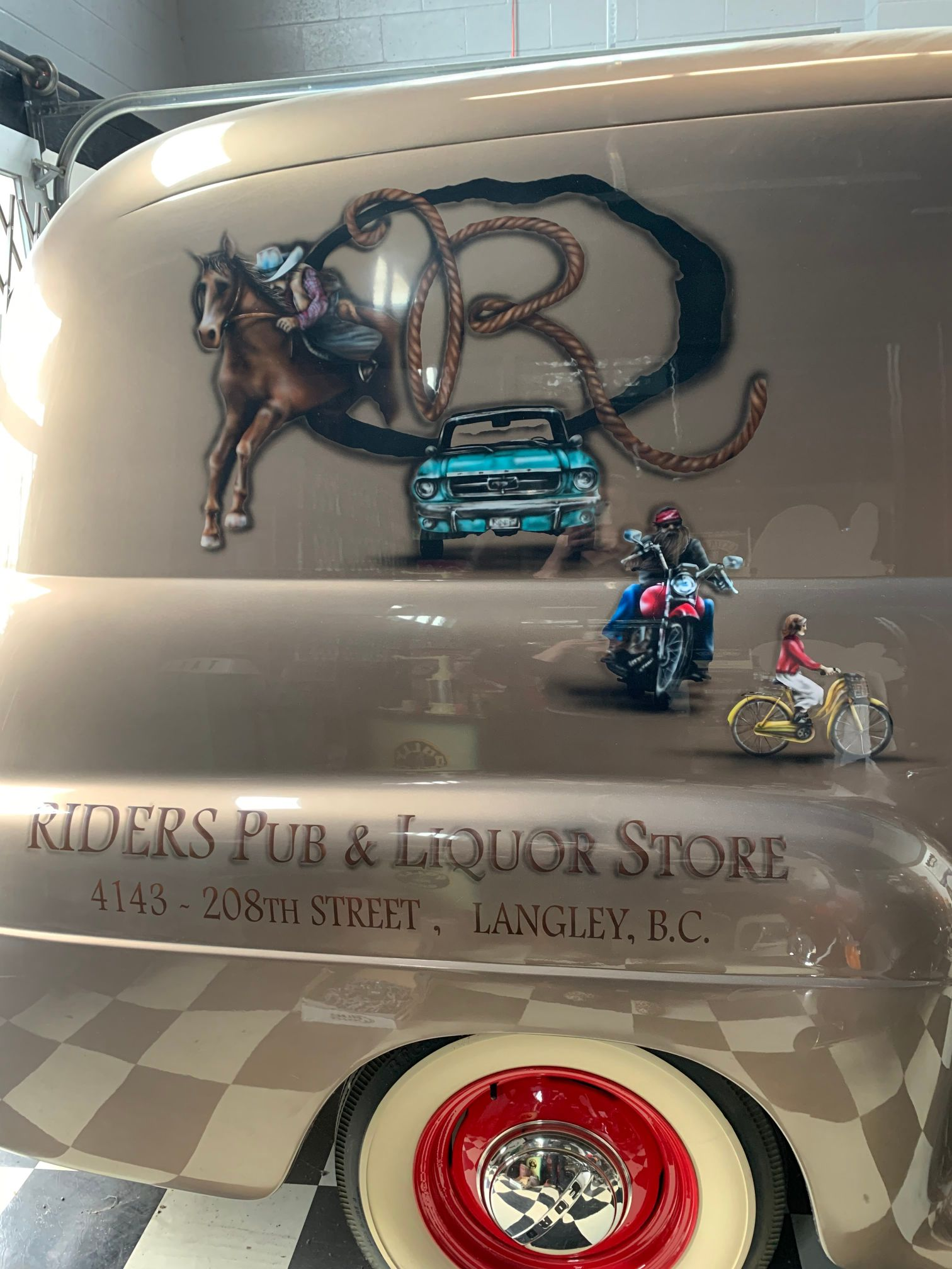 View of Riders Liquor Store branding on a car